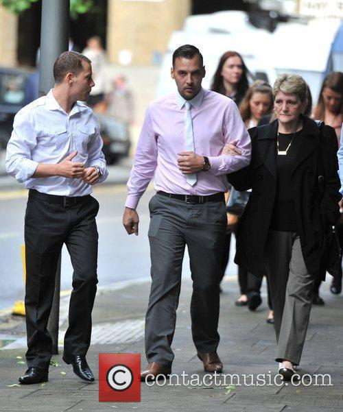 Ian Tomlinson's friends and family arrive at Southwark...