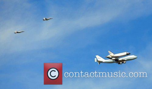 Space Shuttle Endeavour makes its final journey to...