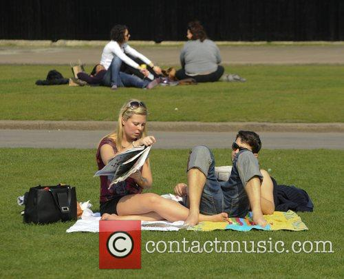 Members of the public enjoy the warm, sunny...