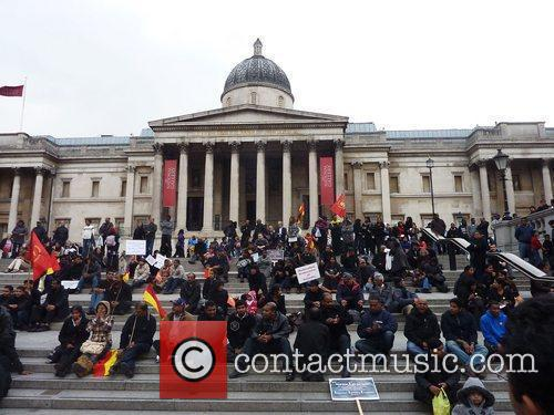 Members of the public gather in Trafalgar Square...