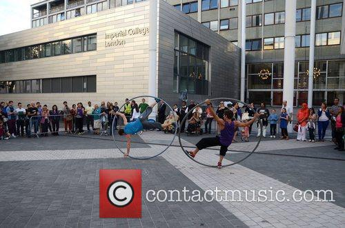 Dance troupe using giant hula hoops display their...