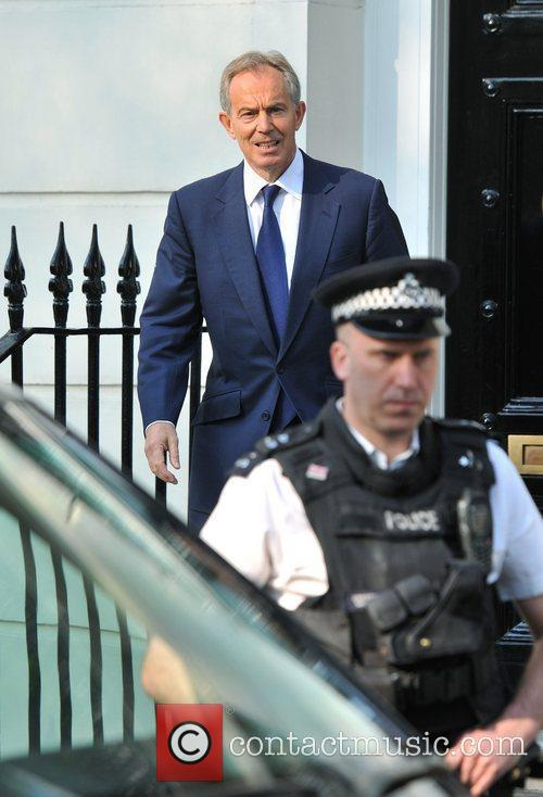 Former British Prime Minister Tony Blair leaves his...