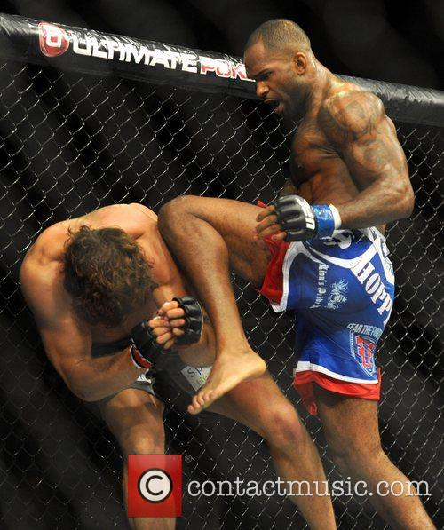 Jimi Manuwa landing a knee on Kyle Kingsbury,...