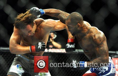 Jimi Manuwa landing a punch on Kyle Kingsbury,...