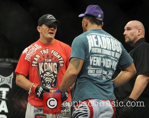 Tom Watson left with Brad Tavares at the...