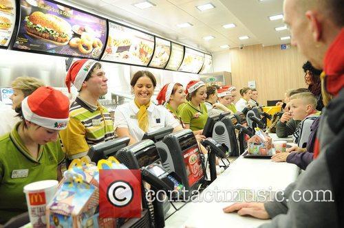 Staff of burger giant Mcdonald's don Santa hats...