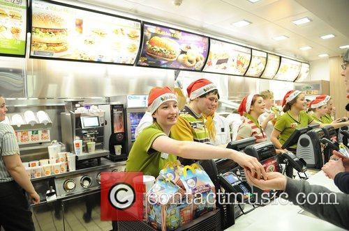 Staff of burger giant Mcdonald's don Santa hats...