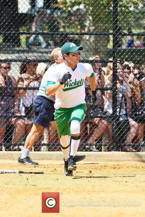 Playing for his Broadway Show League softball team,...
