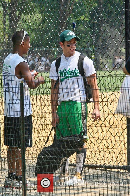 Nick Jonas leaving the field after playing for...