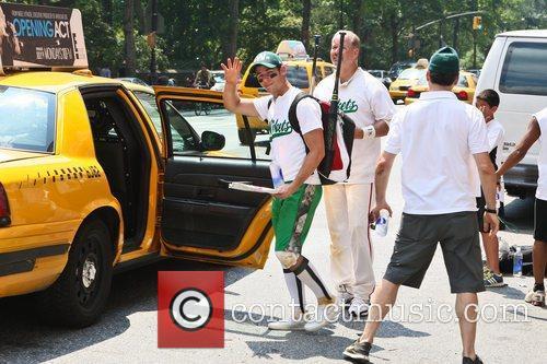 Nick Jonas waves goodbye as he takes a...