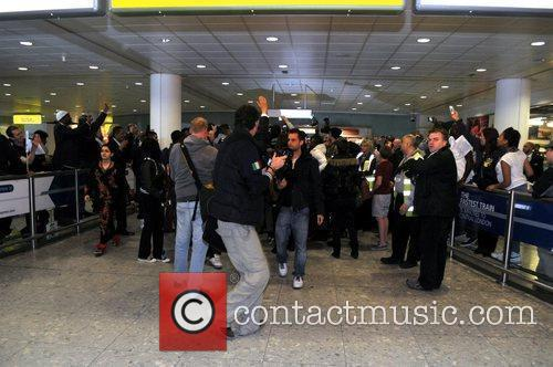 Nicki Minaj is greeted by hundreds of fans...