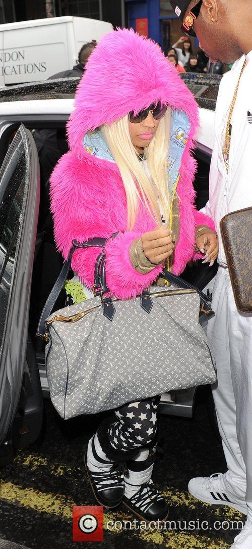 Nicki Minaj arriving at her hotel, wearing a...