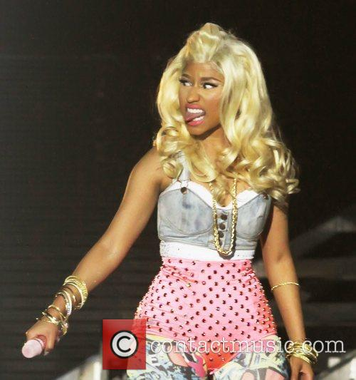 file photos* Rapper Nicki Minaj has found herself...
