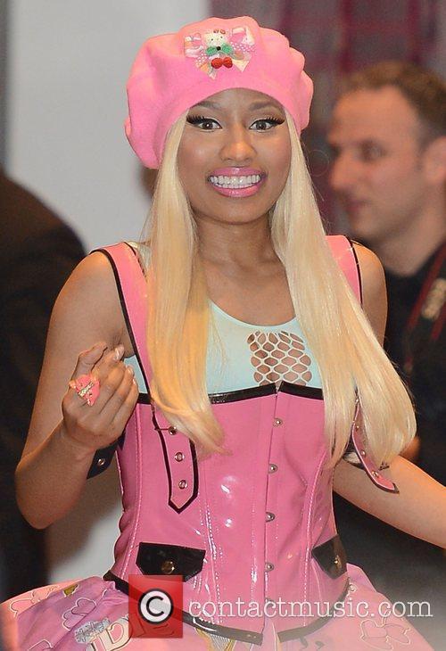 Nicki Minaj signs copies of her new album...
