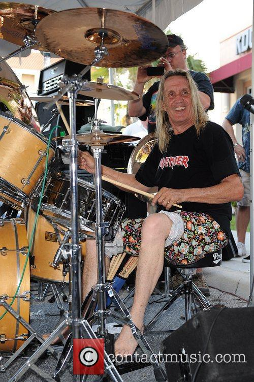 Nicko McBrain of Iron Maiden performs during his...