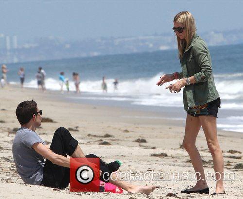 And a male companion relax on Malibu beach...
