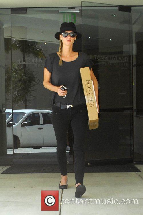 Nicky Hilton leaving a Real Estate Office in...