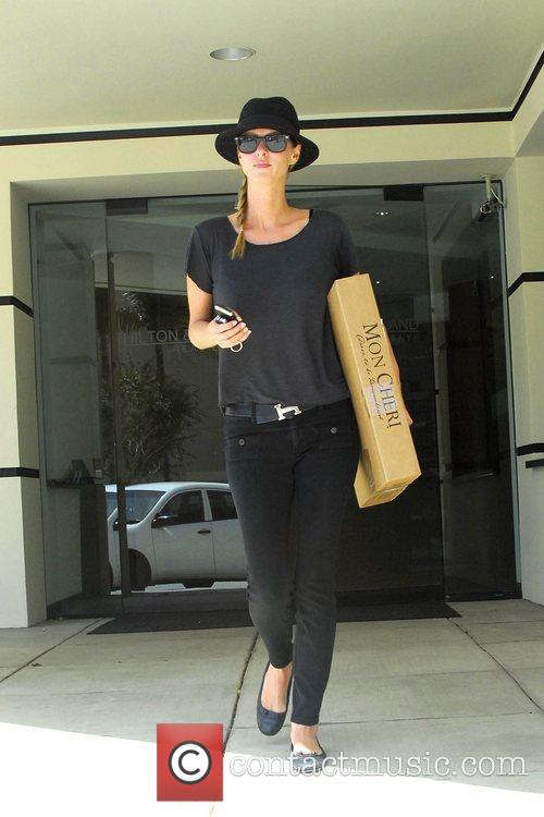 Leaving a Real Estate Office in Beverly Hills