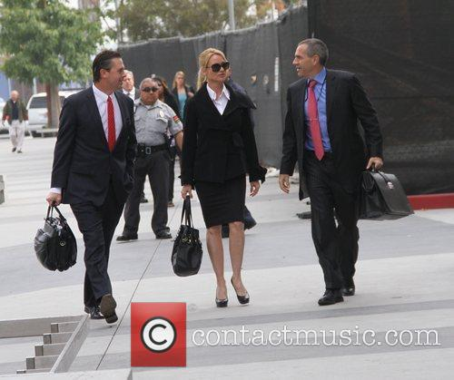 Arriving at the Civil Courthouse with her lawyers