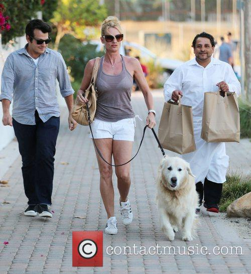 Walking her Golden Retriever at Malibu Country Mart...