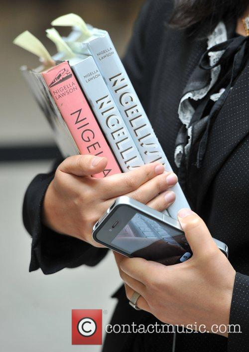 Nigella Lawson signs copies of her new cookbook...