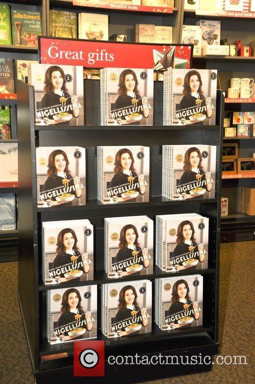 Nigella Lawson signs her new book ' Nigellisima'...