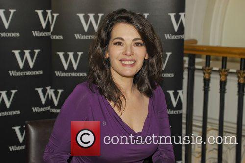 Nigella Lawson signs her new book ' Nigellisima'...