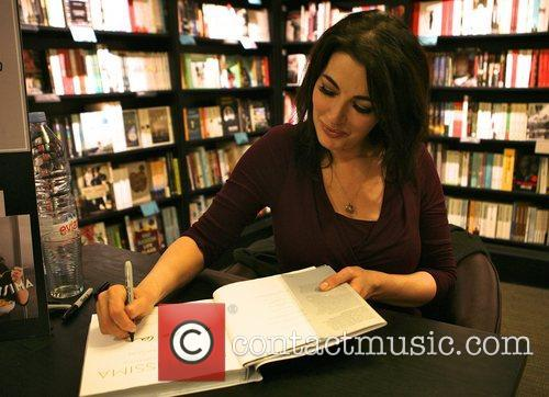 Nigella Lawson  signs copies of her new...