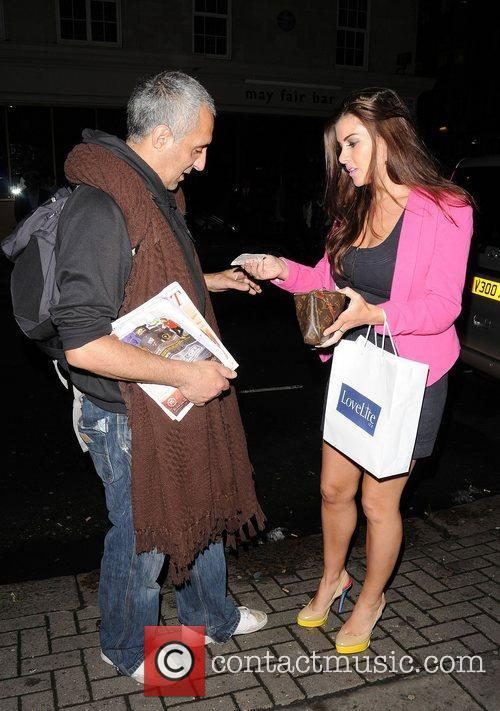 imogen thomas buys a big issue outside 3974950