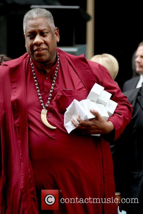Andre Leon Talley, has his arm full of...