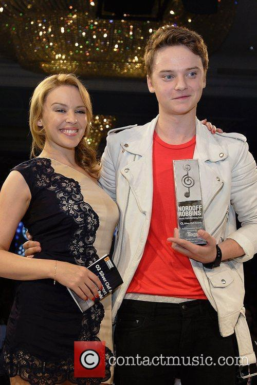Kylie Minouge presents Connor Maynard with the Tag...