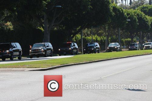 President Barack Obama's motorcade courses through the streets...