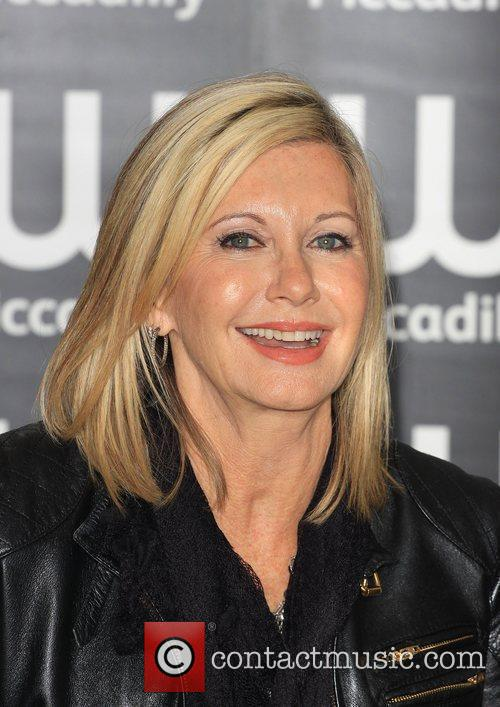 olivia newton john signs copies of her 3835278