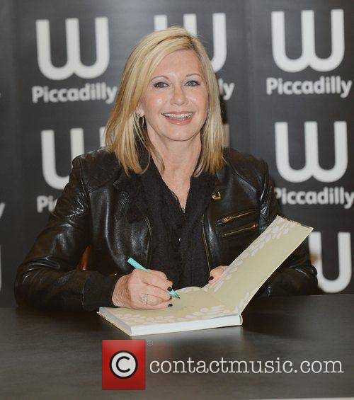olivia newton john signs copies of her 3835453