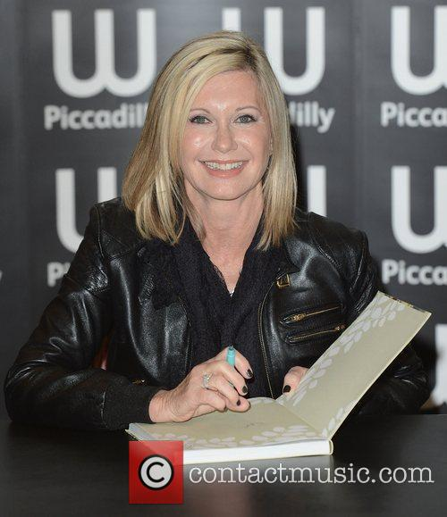 olivia newton john signs copies of her 3835456