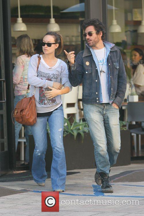Olivia Wilde departs a restaurant with a friend...