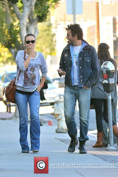 Olivia Wilde shares a laugh with a friend...