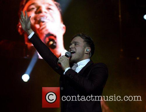 Olly Murs performing on stage at the O2...