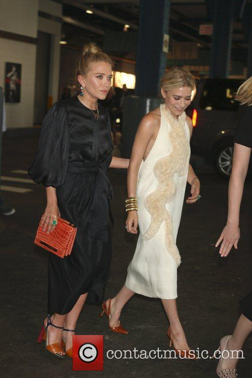 Mary-Kate and Ashley Olsen leave their apartment and...