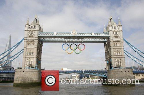 Giant Olympic rings are lowered into position on...