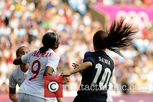 Homare Sawa (Japan) and Candace Chapman (Canada) Women's...