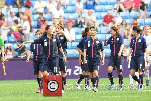 Japan squad celebrates Women's Football first round Group...