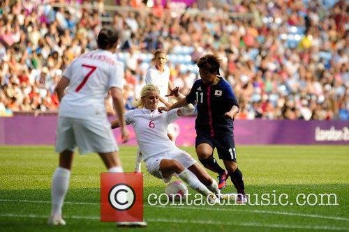 Kaylyn Kyle (Canada) tackles Shinobu Ohno (Japan)...