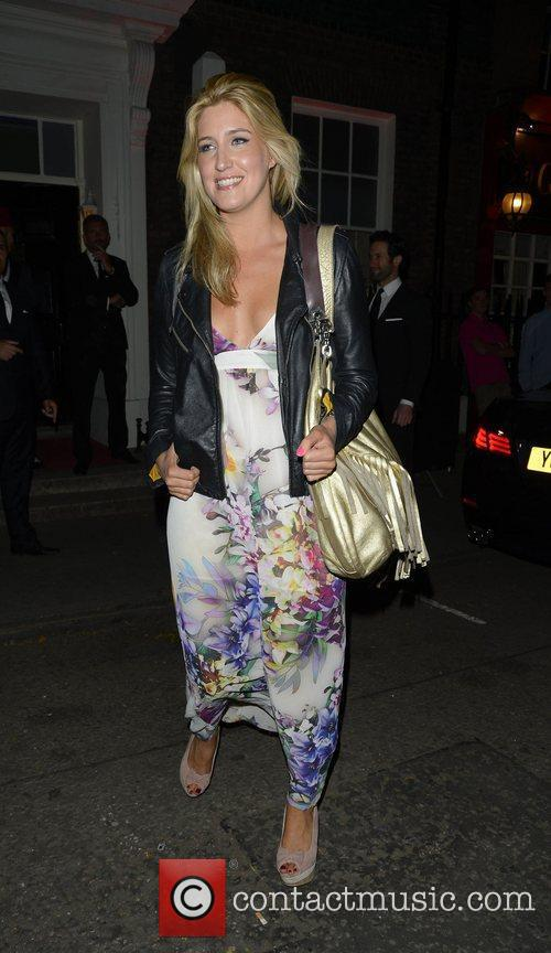 Francesca Hull attending the private opening of OMEGA...