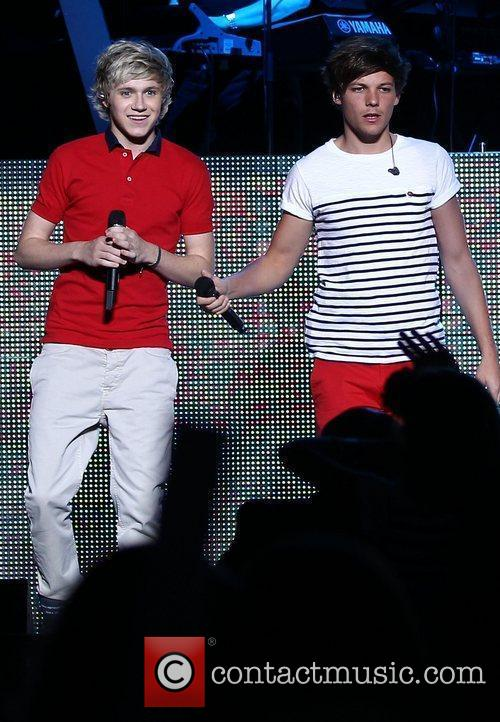 Niall Horan and Louis Tomlinson One Direction perform...