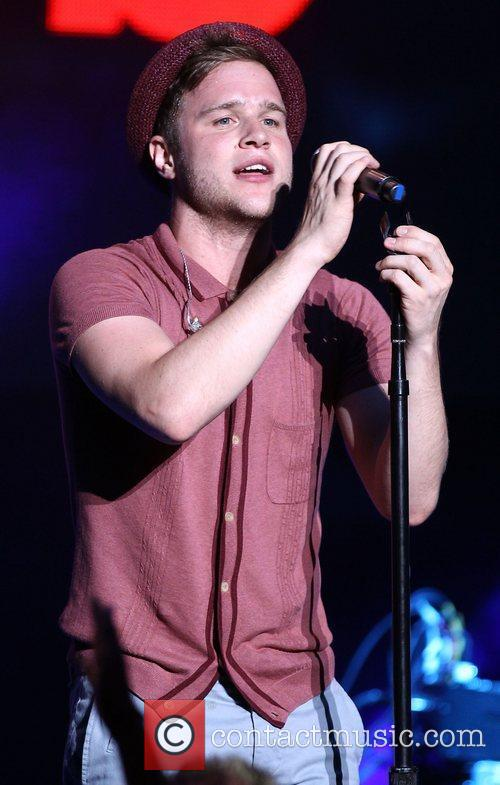 Olly Murs supports One Direction as they perform...