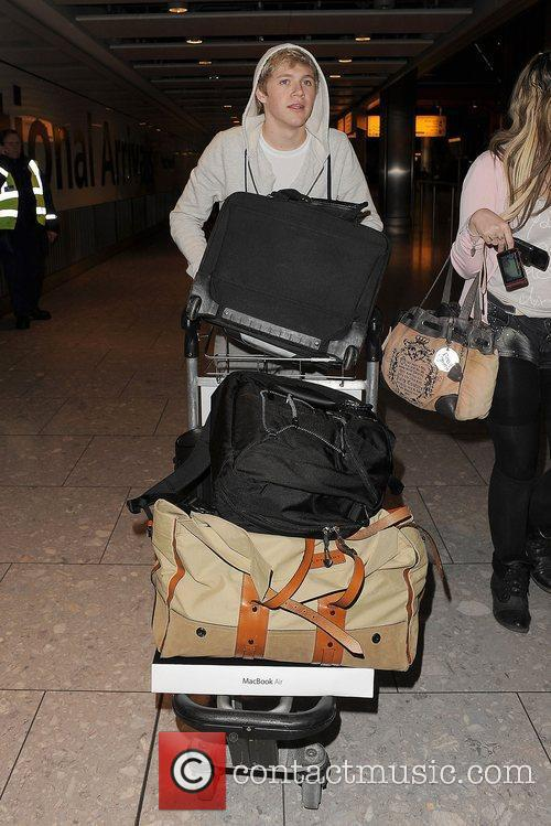 Niall Horan One Direction arrive at Heathrow Airport...