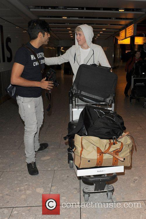 One Direction arrive at Heathrow Airport on alate...