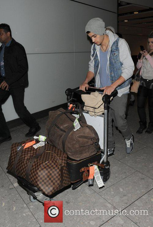 Zayn Malik One Direction arrive at Heathrow Airport...