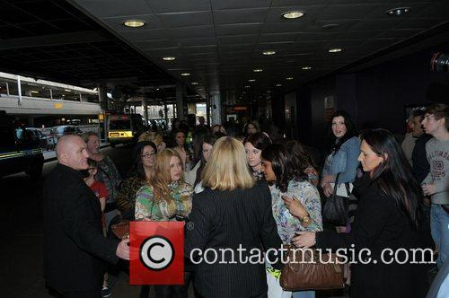 Atmosphere - Fans One Direction arrive at Heathrow...